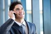 14898992-happy-young-businessman-talking-on-the-mobile-phone
